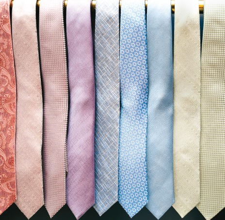 The Tie Bar Ties Hanging on Rack